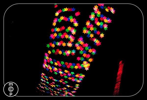 christmas lights in star bokeh shapes