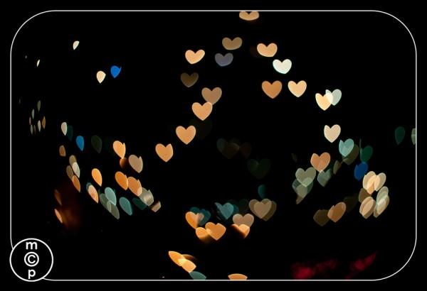 christmas lights in heart bokeh shapes