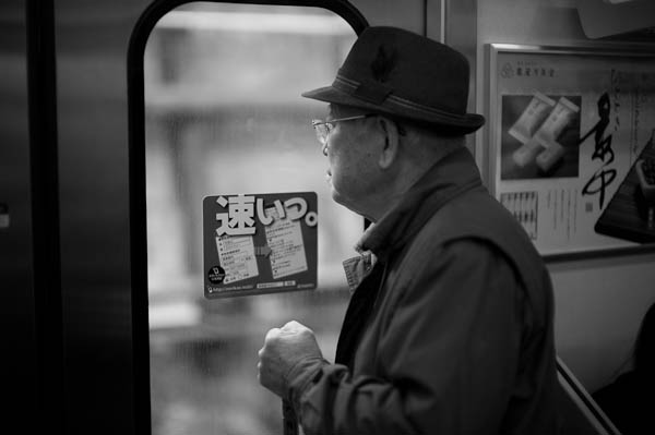 27 old man on train Inside Tokyo: One Photographers View