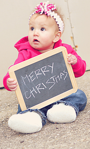 Baby Holding Chalk Board