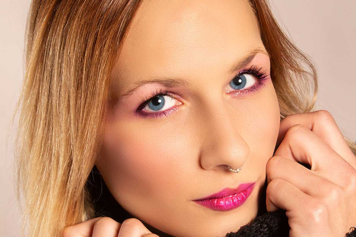 Makeup Toolkit Picture Girl with nose ring No Makeup Sitting After Hot Pink Lipstick