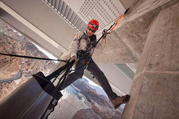 Bridge inspector hanging 840 feet above the Colorado River.
