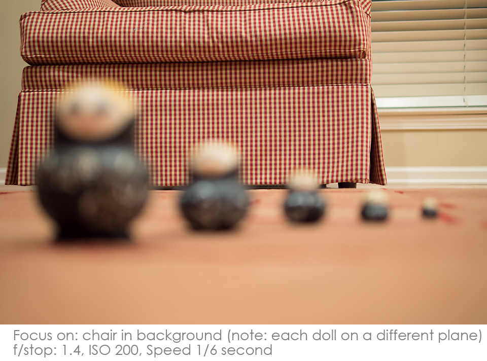 Russian-Matryoshka-Dolls-f1.4-chair Depth of Field: A Visual Lesson Activities Photography Tips