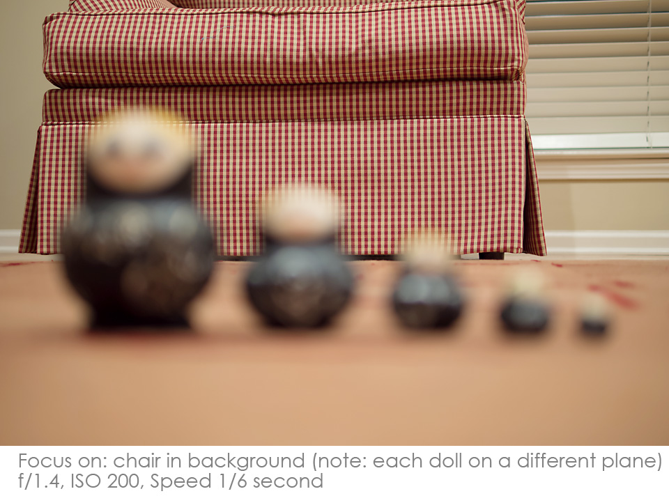Russian-Matryoshka-Dolls-f1.4-same-plane-chair Depth of Field: A Visual Lesson Activities Photography Tips