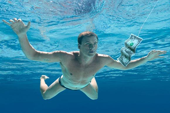"Swimmer Ryan Lochte underwater, recreating Nirvana's ""Nevermind"" album cover"