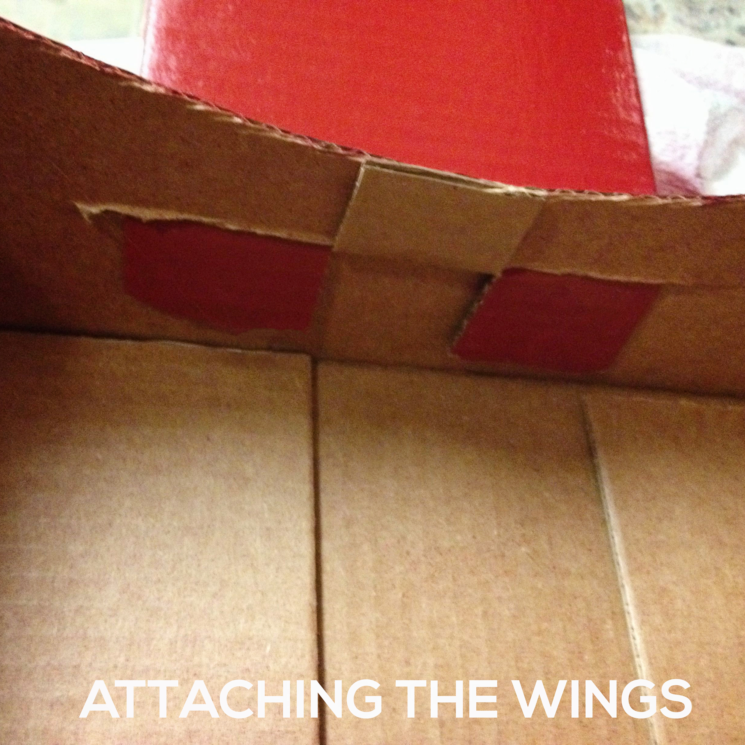 attaching-wings Make a DIY Box Airplane Prop for Newborn Photography Guest Bloggers Photography Tips Uncategorized
