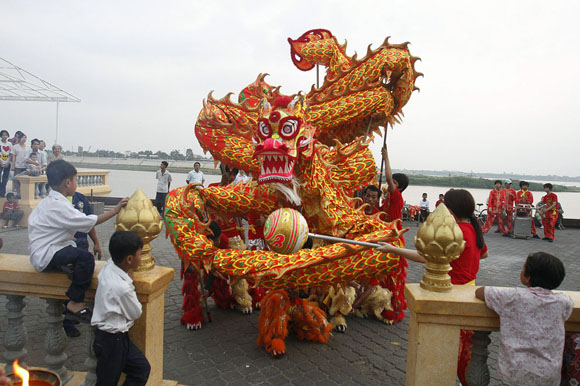people performing dragon dance for Chinese New Year.