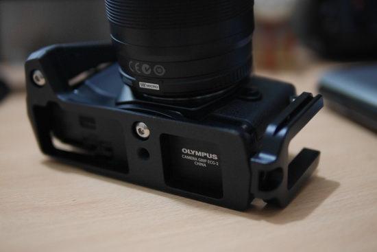 olympus-ecg-2-camera-grip Olympus 14-150mm f/4-5.6 II zoom lens photos revealed Rumors
