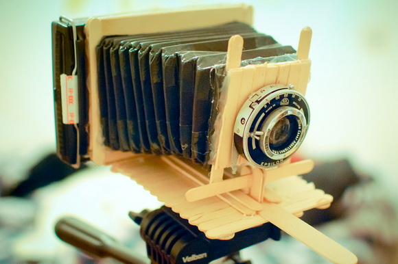 Polaroid instant camera was created using popsicle sticks and duct tape