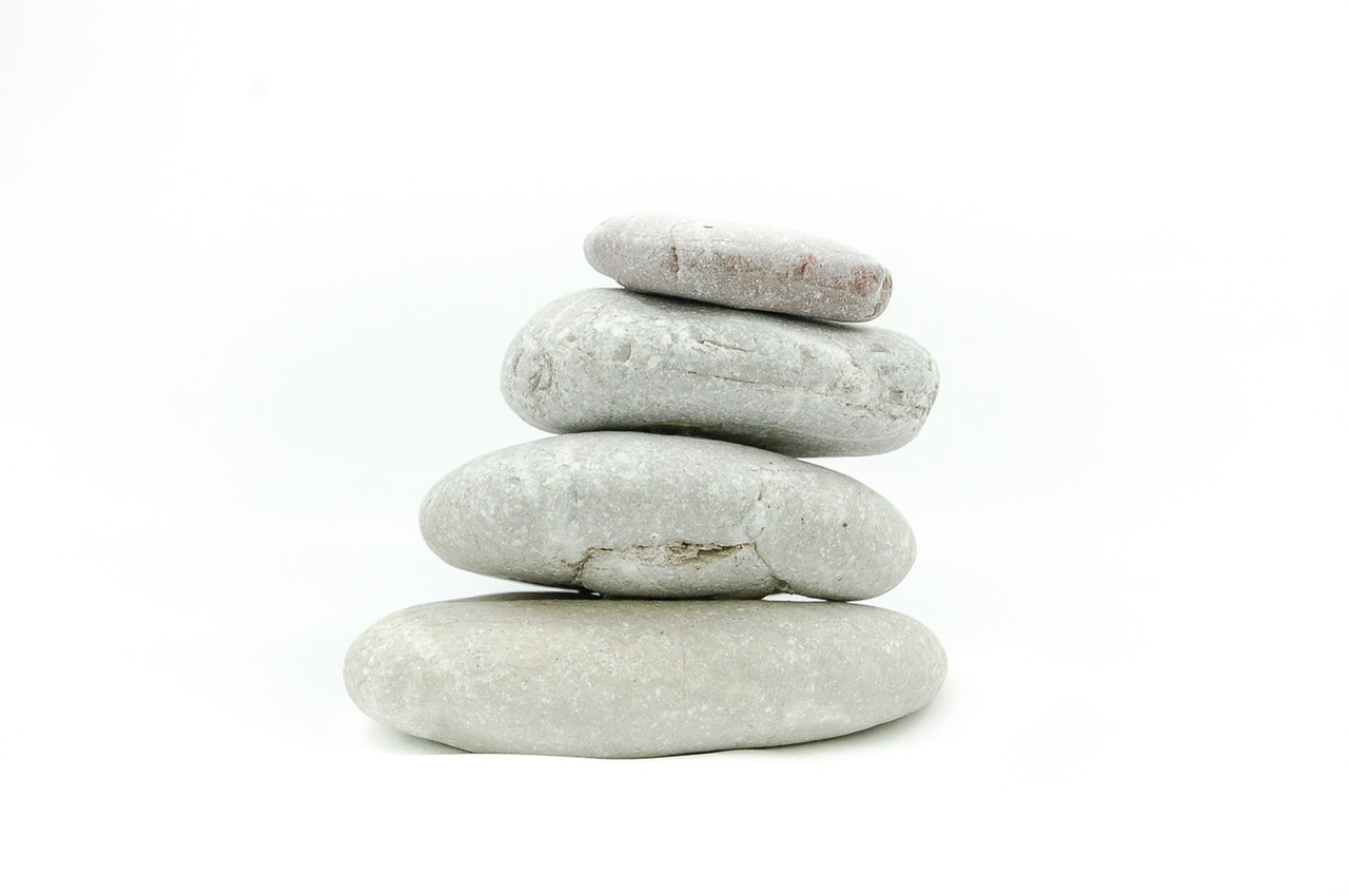 the-stones-stone-on-a-white-background-zen-50604 Photography Essentials for Absolute Beginners Uncategorized