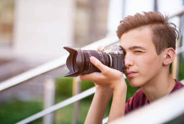 teenage-boy-taking-photos-outdoors-832LZPS-1 Learn Photoshop Checkout